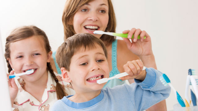 kids cleaning teeth for oral health